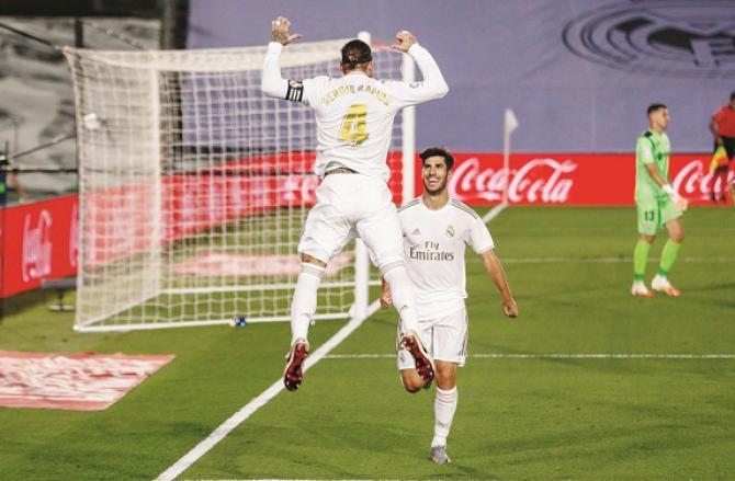 Real Madrid players celebrate. Photo: INN