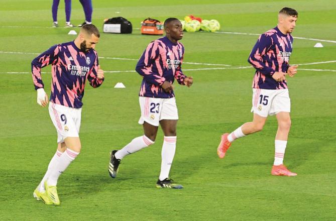 LK Karim Benzema running with another teammate..Picture:INN