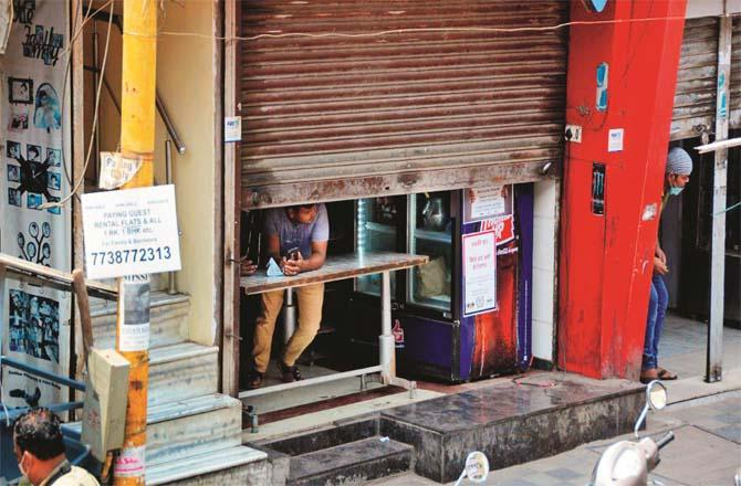 The shutters of a shop and a hotel are half open.Picture: Syed Samir Abidi