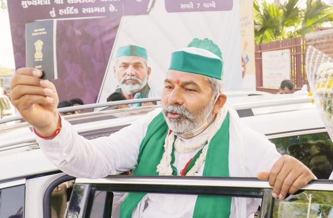 Rakesh Tikit showing his passport outside Sabarmati Ashram. Picture: PTI