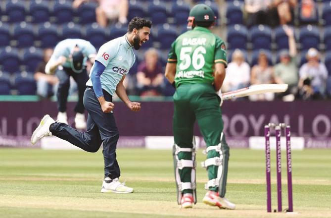 England bowler Mahmood Saqib dismissing Babar Azam. Picture:INN