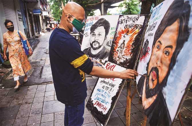 An artist paints Danish Siddiqui. Picture: PTI