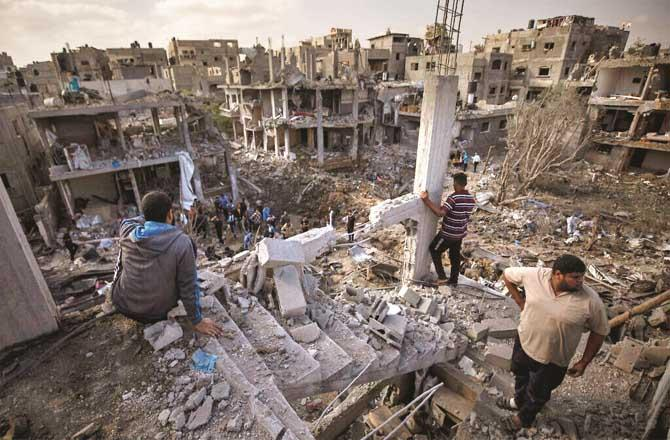 Buildings destroyed in the Israeli attack on Gaza in May, in which more than two and a half hundred Palestinians were killed. (File photo)