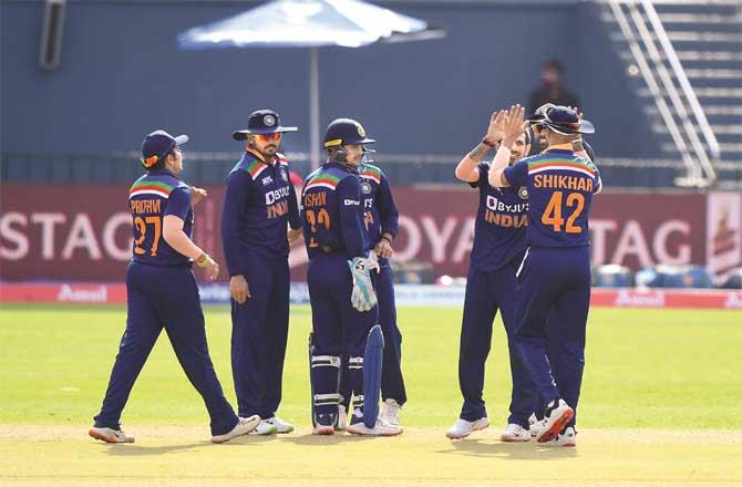 Indian players cheer on each other after dismissing the Sri Lankan batsman.Picture:PTI