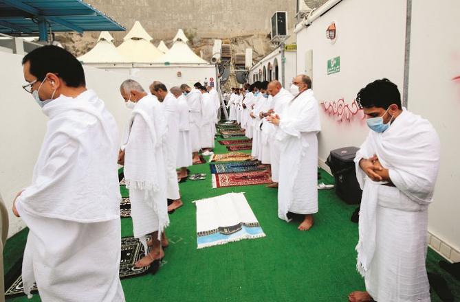 Hajj pilgrims praying after reaching Mina.Picture: Courtesy Arab News