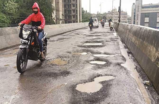 Many motorcyclists have lost their lives in accidents due to potholes on Rajiv Gandhi flyover.Picture:Inquilab
