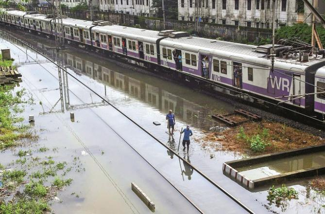 Train tracks appear to be submerged .Picture:PTI