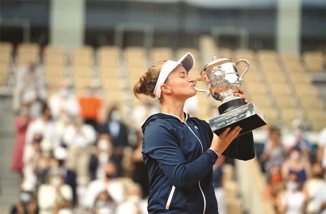 French Open women`s finalist Czech Republic`s Barbora Krajsekova kisses the trophy.Picture:PTI