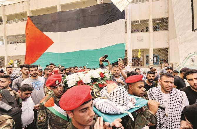 Security forces carry the body of a Palestinian official.Picture:PTI
