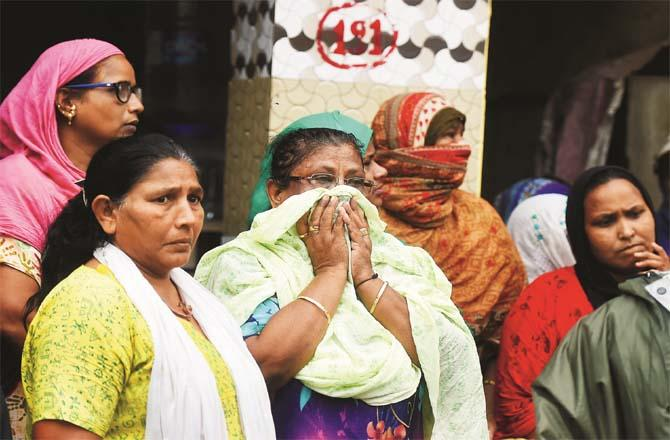 Relatives, friends and neighbors of the victims could not control their emotions after the accident in malwani.Picture:PTI