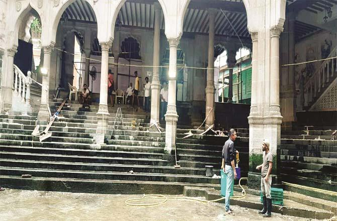 Staff are seen cleaning the pool of the historic Jama Masjid in Arus al-Balad.Picture:Inquilab
