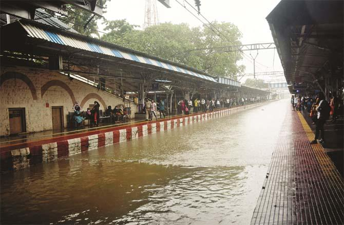 The sign station train tracks appear to be submerged in water.Picture:Inquilab