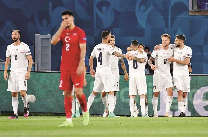 Italian players (in white jerseys) congratulate each other after scoring.Picture:PTI