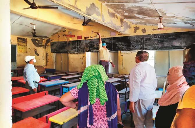 Rainwater from the roof of the school is being pumped out of the classroom.Picture:Inquilab