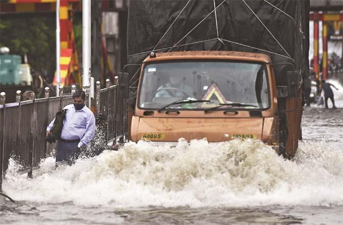 Train and bus service affected due to accumulation of water on road and railway track.Picture:PTI