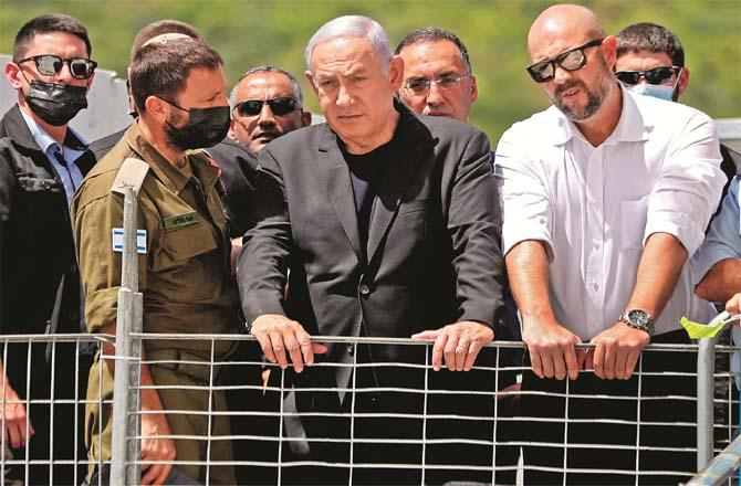 Netanyahu inspects the crash site with officials.Picture:PTI