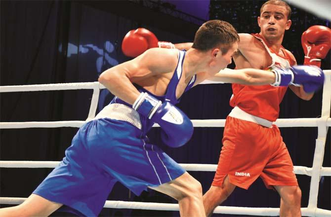 Boxer Amit Panghal stops opponent`s punch in Asian Championship semifinals.Picture:PTI