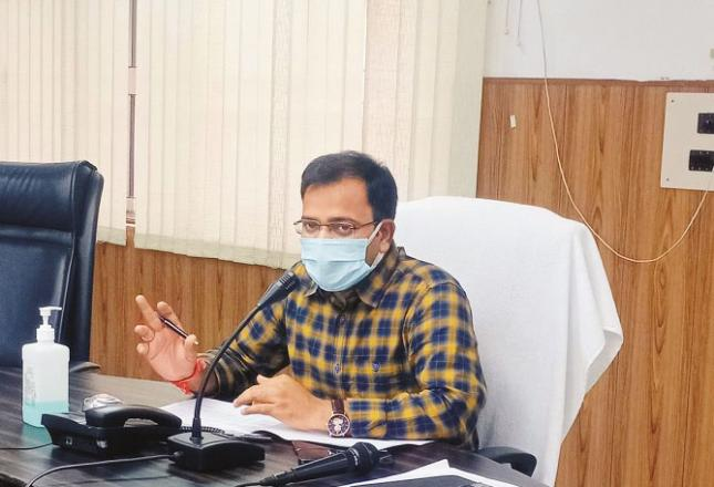 District Magistrate Ramesh Ranjan during a meeting at the Collectorate Auditorium..Picture:INN
