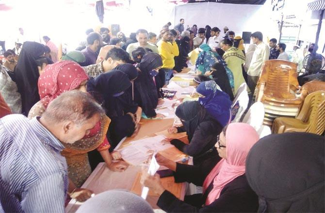 Forms are being filled in the camp for income certificate.Picture:Inquilab