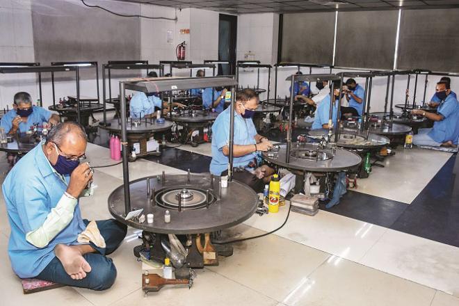 Craftsmen working in a diamond factory in Surat.Picture:INN