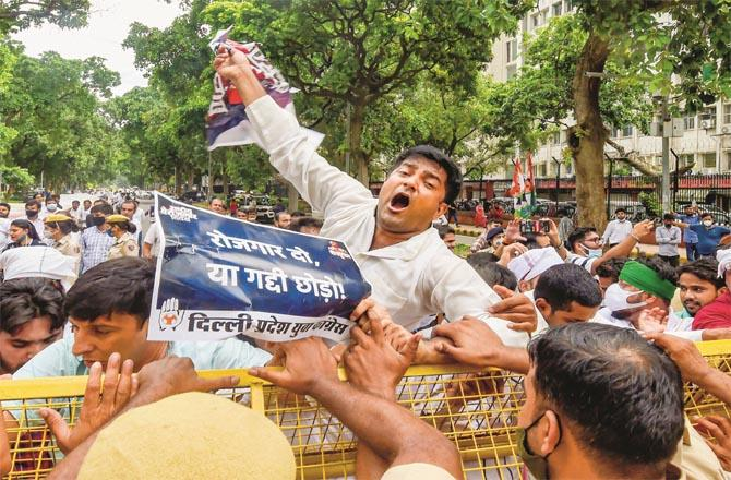 Youth Congress workers protested in several places in Delhi. Police had to set up barricades to stop them:Picture:PTI